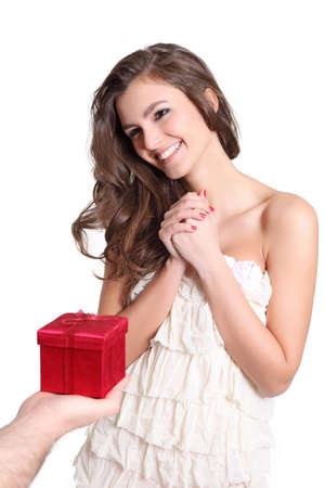 Young woman receiving a red box