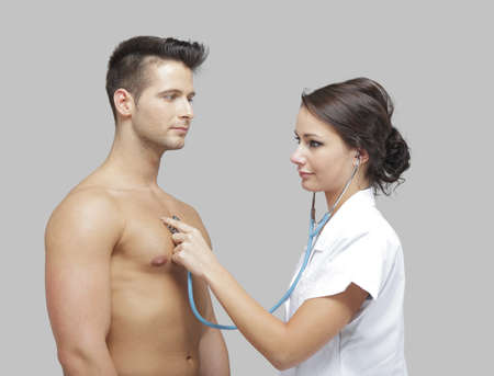 Beautiful doctor examining a men photo