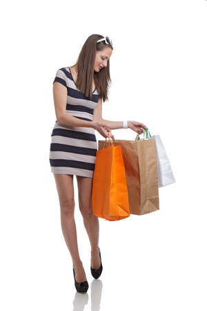 Cute woman shopping with bags photo