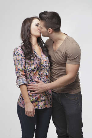 Cute couple kissing in the studio Stock Photo
