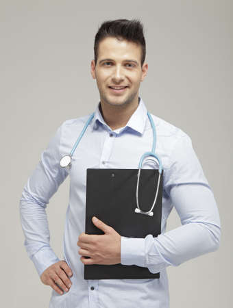 Confident and handsome doctor with a stethoscope photo