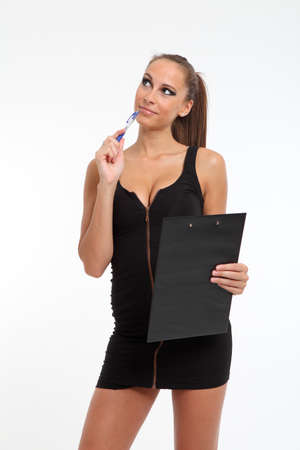 Hot business women with a clipboard and pen Stock Photo