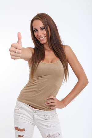 Brunette beauty showing thumbs up