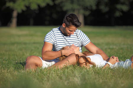 Romantic moments between a couple in the park Stock Photo