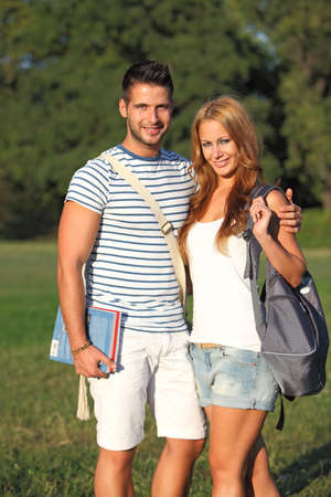 Cute students together in the nature with books photo