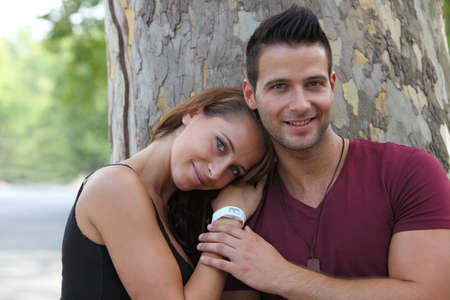 couples hug: Romantic moments between a couple in the park Stock Photo
