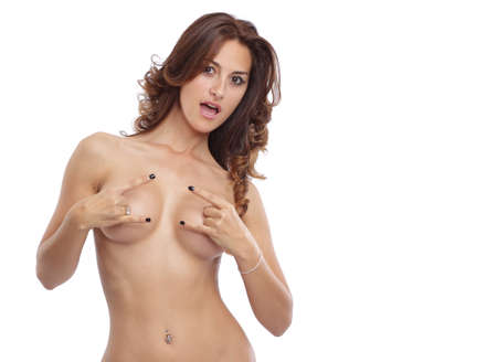 topless brunette: Cool looking topless woman in studio Stock Photo