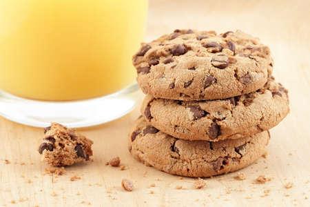 Fresh orange juice with cookie pile photo