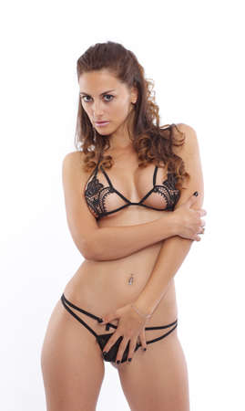 Attractive brunette wearing black lingerie Stock Photo