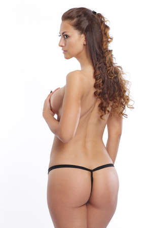 Topless woman from behind Stock Photo