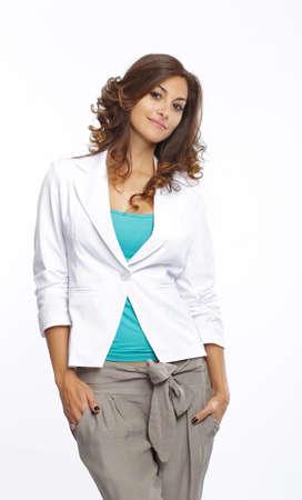 Smiling brunette standing in hellen Kleidern