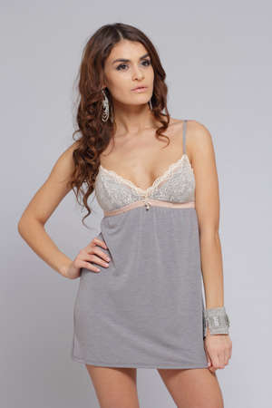 nightgown: Brunette posing in grey nightgown Stock Photo