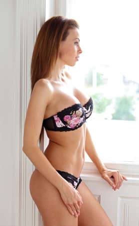 Wondering in lingerie Stock Photo