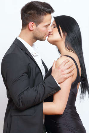 Cute and elegant couple kissing each other photo
