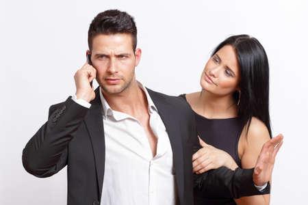 Gesch�ftsmann bel�stigt von seiner Freundin Lizenzfreie Bilder
