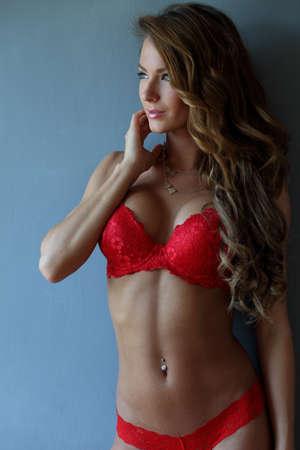 Brunette girl in red lingerie