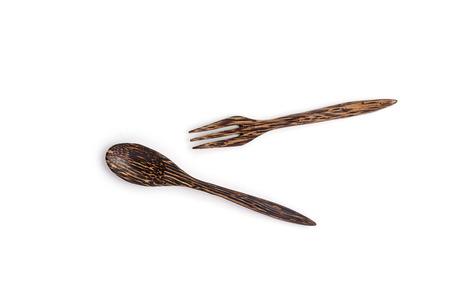 Wooden spoon and fork on white background