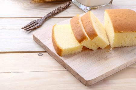 Butter cake on wooden background Foto de archivo