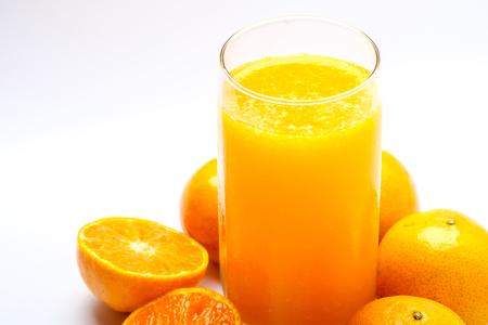 Fresh orange juice on white background Stock Photo