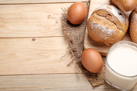milk and bread on wooden background