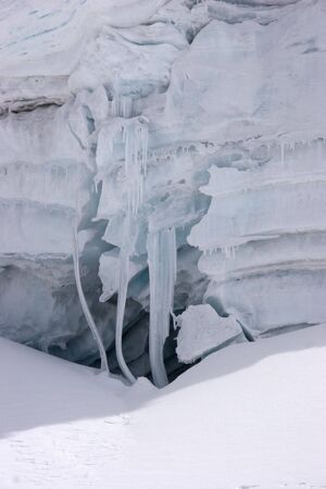 cornice: Ice cornice in an icefall with icicles curved with constant winds, Cordillera Blanca mountains Stock Photo