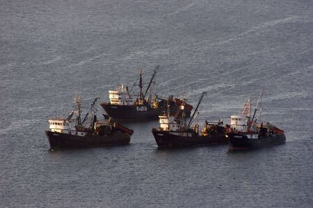 Group of trawlers in the ocean Stock Photo