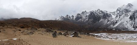 Sand beach near snow mountains, Himalaya, Nepal