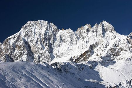 Blue sky over mountains after snowfall, Himalayas Stock Photo