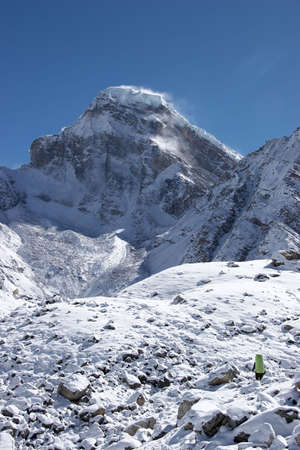 Mountaineer going toward snow mountain, Himalayas Stock Photo - 5364397