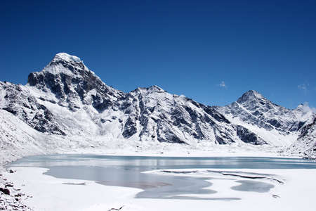Icy lake and mountains, Himalaya, Nepal photo