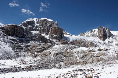 Rocky wall and a glacier, Himalayas, Nepal Stock Photo - 5364402