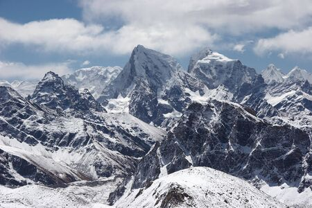 Clouds over snow mountains landscape, Himalaya Stock Photo - 5364409
