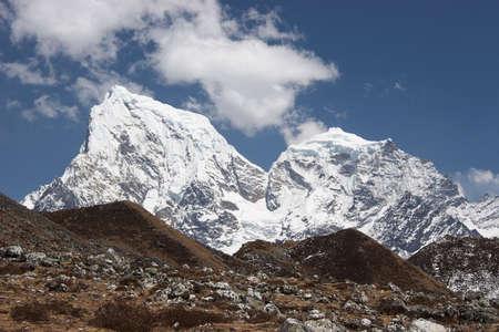 Snow mountains above grass hills, Himalaya Stock Photo - 5364414