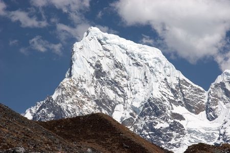 Snow summit of Cholatse mountain, Himalaya Stock Photo - 5364405