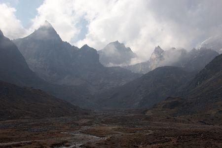 Clouds over rocky mountains, Himalaya, Nepal