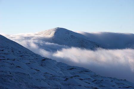 Clouds going down through a mountain pass Stock Photo - 6076406