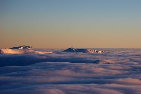 Mountains above the clouds at sunset Stock Photo - 6076413