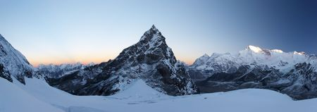 Rocky summit at sunrise panorama, Himalaya, Nepal Stock Photo