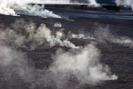 Steam rising from geyser field, Chile Stock Photo