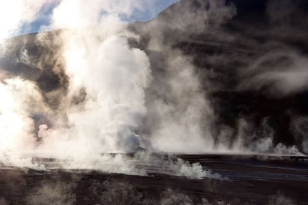 Vapor rising from geyser field, Chile