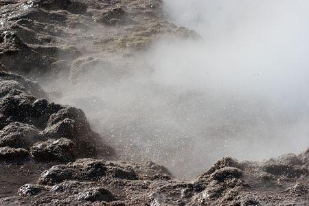 Geyser eruption, El Tatio geyser valley, Chile photo