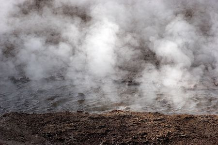 Steam rising from hot spring, geyser field, Chile Stock Photo