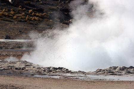 Geyser eruption, El Tatio geyser field, Chile photo
