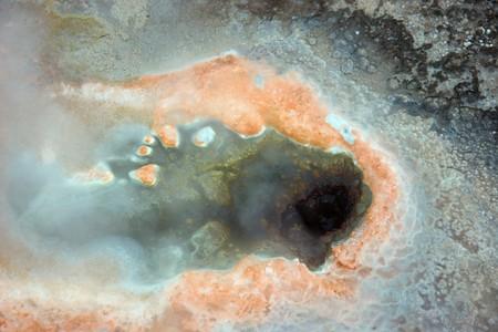 Geyser hole with orange sediments