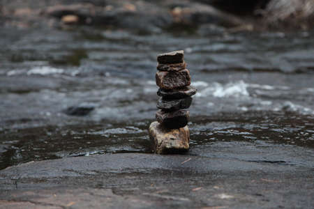 Stacked stones at the edge of a river