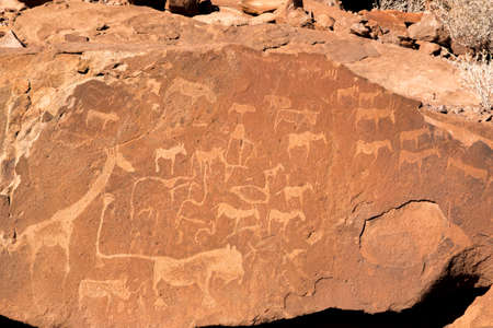 Ancient rock engravings in Twyfelfontein, Namibia were made with quartz tools. Stock Photo
