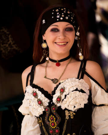 One of many women dressed in period costume at the Renaissance festival in the Phoenix area. Each played a role whether merchant, musician, particpant or visitor.