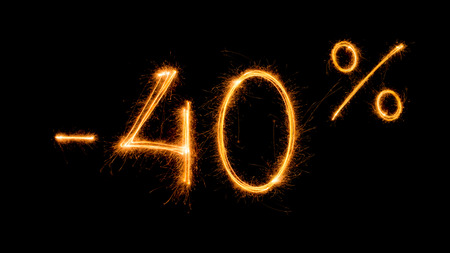 Sale 40 procent off - made with sparklers on black background.