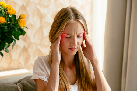 Headache of woman, head pain and stress or depression concept. Stock Photo