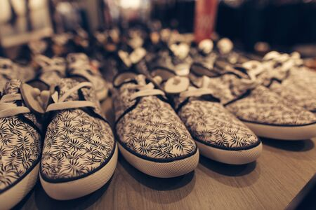 Men shoes in clothes store. Stylish young mens shoes in a clothing store. Shopping concept